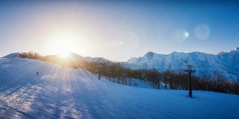 Sunset over a Hakuba ski resort slope