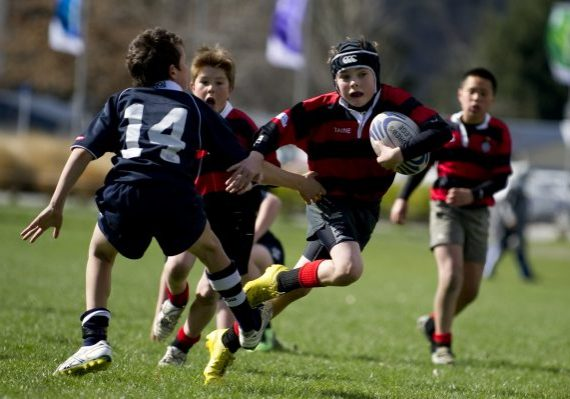 Boys playing rugby at Global Games New Zealand